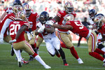 Atlanta Falcons running back Devonta Freeman, center, runs against the San Francisco 49ers during the first half of an NFL football game in Santa Clara, Calif., Sunday, Dec. 15, 2019. (AP Photo/Josie Lepe)