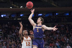 Lipscomb guard Nathan Moran (5) goes to the basket past Texas guard Kerwin Roach II (12) during the second half of the championship game in the National Invitational Tournament, Thursday, April 4, 2019, at Madison Square Garden in New York. Texas won 81-66. (AP Photo/Mary Altaffer)
