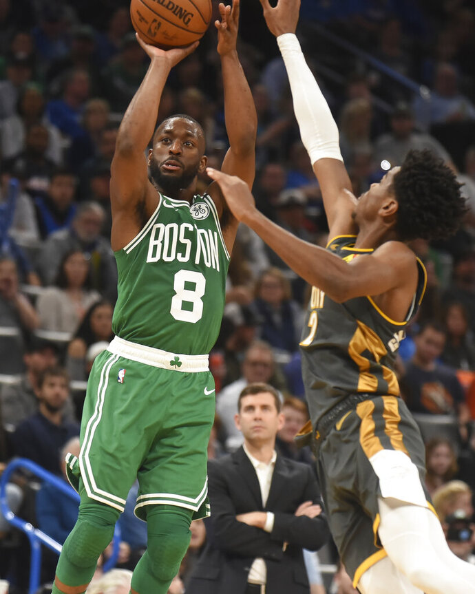 Boston Celtics Kemba Walker (8) shoots over Oklahoma City Thunder guard Shai Gilgeous-Alexander (2) in the second half of an NBA basketball game, Sunday, Feb. 9, 2020, in Oklahoma City. (AP Photo/Kyle Phillips)