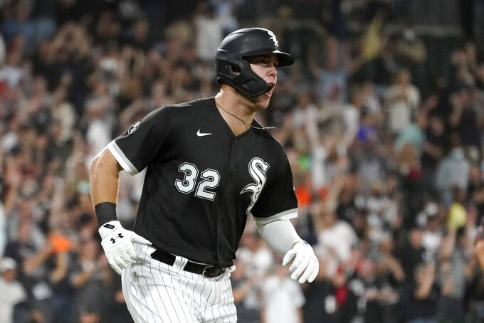 Chicago White Sox's Gavin Sheets yells after hitting his three-run home run off Los Angeles Angels relief pitcher Andrew Wantz during the third inning of a baseball game Tuesday, Sept. 14, 2021, in Chicago. (AP Photo/Charles Rex Arbogast)