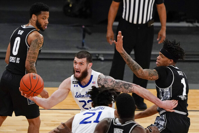 Seton Hall's Sandro Mamukelashvili (23) drives past Georgetown's Jamorko Pickett (1) during the second half of an NCAA college basketball game in the semifinals in the Big East men's tournament Friday, March 12, 2021, in New York. (AP Photo/Frank Franklin II)
