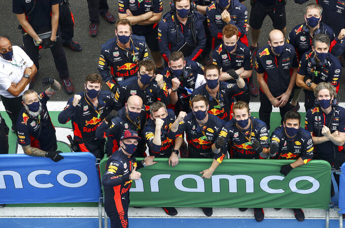 Red Bull driver Max Verstappen of the Netherlands celebrates with his mechanics after the Hungarian Formula One Grand Prix race at the Hungaroring racetrack in Mogyorod, Hungary, Sunday, July 19, 2020. (Mark Thompson/Pool via AP)