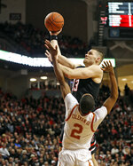 Texas Tech's Matt Mooney (13) shoots over Texas' Matt Coleman III (2) during the first half of an NCAA college basketball game Monday, March 4, 2019, in Lubbock, Texas. (AP Photo/Brad Tollefson)