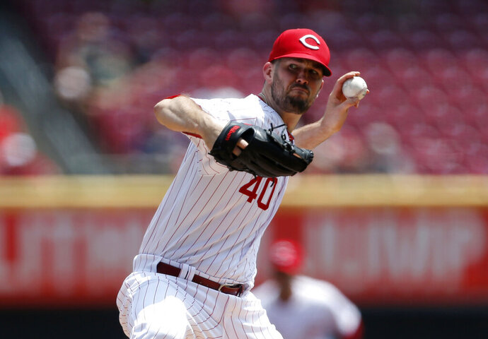 FILE - In this July 28, 2019 file photo, Cincinnati Reds starting pitcher Alex Wood throws against the Colorado Rockies during the first inning of a baseball game in Cincinnati. The Dodgers acquired Wood in the offseason. In what's become a familiar refrain, the Dodgers arrive at camp still looking for their first World Series championship since 1988. After losing in two straight World Series, they were ousted by Washington in five games in the NL Division Series last fall. (AP Photo/Gary Landers, File)