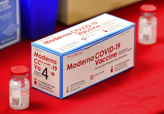 A box of vials of the Moderna vaccine for the COVID-19 coronavirus on display during a press conference with Florida governor Ron DeSantis touting the expanded rollout of the state vaccination program, at Orlando Health South Seminole Hospital in Longwood, Fla., Monday, Jan. 4, 2021. (Joe Burbank/Orlando Sentinel via AP)