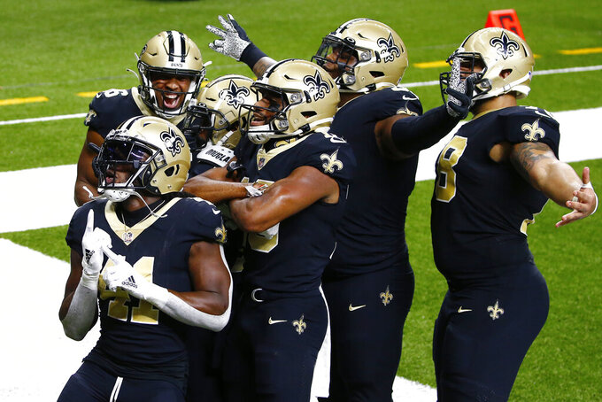 New Orleans Saints running back Alvin Kamara (41) celebrates with teammates after a touchdown reception by wide receiver Emmanuel Sanders in the first half of an NFL football game against the Green Bay Packers in New Orleans, Sunday, Sept. 27, 2020. (AP Photo/Butch Dill)