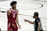 Arkansas forward Justin Smith (0) questions a call with a referee during the second half of an Elite 8 game against Baylor in the NCAA men's college basketball tournament at Lucas Oil Stadium, Monday, March 29, 2021, in Indianapolis. (AP Photo/Darron Cummings)