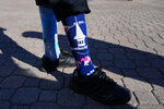 A man wears Kentucky Derby-themed socks before the 147th running of the Kentucky Derby at Churchill Downs, Saturday, May 1, 2021, in Louisville, Ky. (AP Photo/Brynn Anderson)