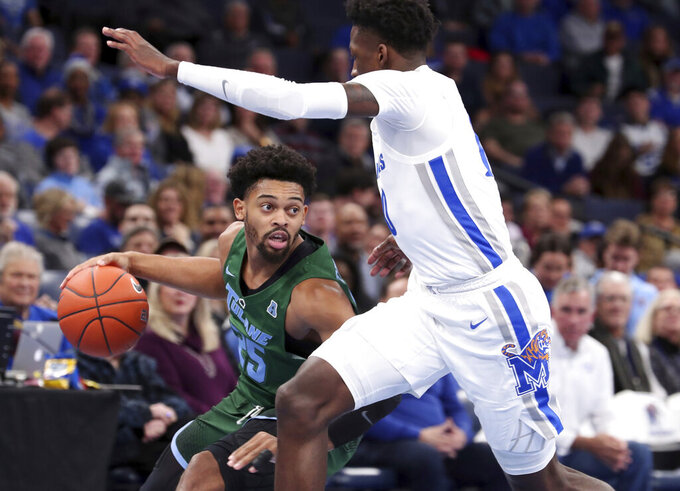 Memphis guard Damion Baugh, right, defends against Tulane guard Christion Thompson (25) who looks to pass in the first half of an NCAA college basketball game Monday, Dec. 30, 2019, in Memphis, Tenn. (AP Photo/Karen Pulfer Focht)