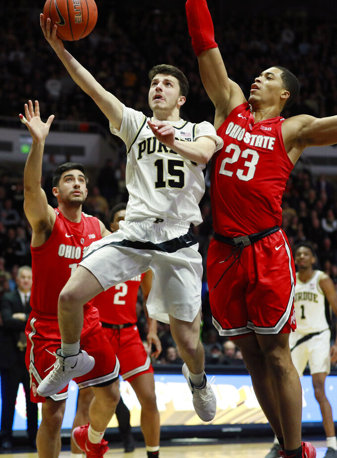 Purdue guard Tommy Luce (15) shoots the basketball defended by Ohio State forward Jaedon Ledee (23) and guard Joey Lane in the second half of an NCAA college basketball game, Saturday, March 2, 2019, in West Lafayette, Ind. Purdue won 86-51. (AP Photo/R Brent Smith)