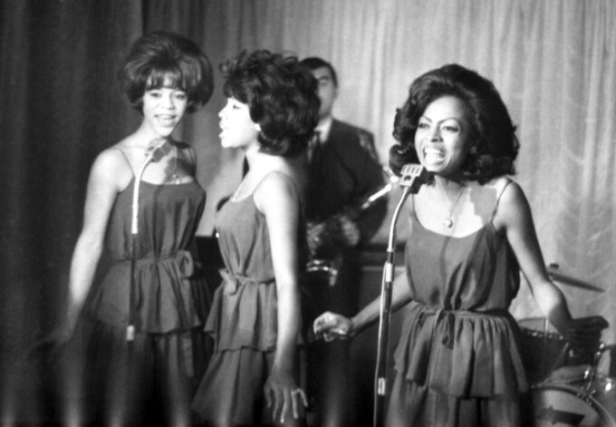 FILE - In this Oct. 8, 1964 file photo, The Supremes, from left, Florence Ballard, Mary Wilson and Diana Ross, perform during a reception for them in a hotel, in London. Wilson, the longest-reigning original Supreme, has died at 76 years old. Publicist Jay Schwartz says Wilson died Monday, Feb. 8, 2021, at her home in Las Vegas and that the cause was not immediately clear. (AP Photo/Bob Dear, File)