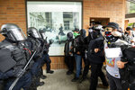 Police officers face off against protesters opposed to right-wing demonstrators following an