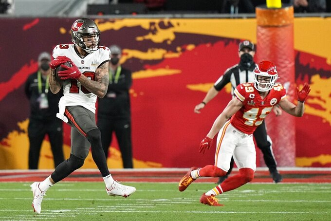 Tampa Bay Buccaneers wide receiver Mike Evans (13) makes the catch against Kansas City Chiefs free safety Daniel Sorensen (49) during the first half of the NFL Super Bowl 55 football game Sunday, Feb. 7, 2021, in Tampa, Fla. (AP Photo/David J. Phillip)