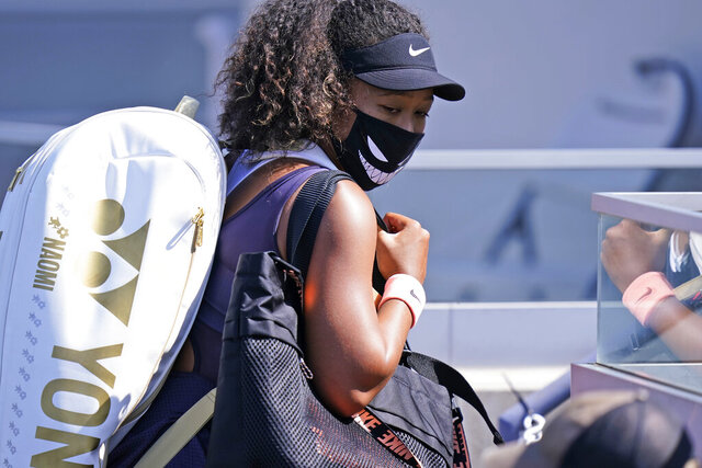 Naomi Osaka, of Japan, leaves the court after winning her match with Anett Kontaveit, of Estonia, during the quarterfinals at the Western & Southern Open tennis tournament Wednesday, Aug. 26, 2020, in New York. (AP Photo/Frank Franklin II)