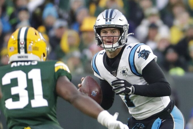 Carolina Panthers' Kyle Allen looks to pass during the first half of an NFL football game against the Green Bay Packers Sunday, Nov. 10, 2019, in Green Bay, Wis. (AP Photo/Morry Gash)