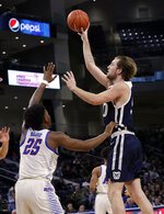 Butler center Joey Brunk, right, shoots against DePaul forward Femi Olujobi during the first half of an NCAA college basketball game Wednesday, Jan. 16, 2019, in Chicago. (AP Photo/Nam Y. Huh)