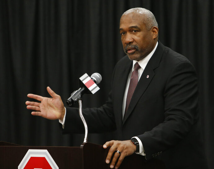 Ohio State athletics director Gene Smith answers questions during a news conference, Tuesday, Dec. 4, 2018, in Columbus, Ohio. Ohio State's athletic department will cut 25 jobs, furlough hundreds of other employees and ask coaches and others to take 5% pay cuts to help grapple with a projected $107 million budget deficit due to the COVID-19 pandemic, athletic director Gene Smith said Wednesday, Sept. 23, 2020. (AP Photo/Jay LaPrete)