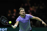Stan Wawrinka of Switzerland plays a shot against Gael Monfils of France in the men's singles final of the ABN AMRO world tennis tournament at Ahoy Arena in Rotterdam, Netherlands, Sunday, Feb. 17, 2019. (AP Photo/Peter Dejong)