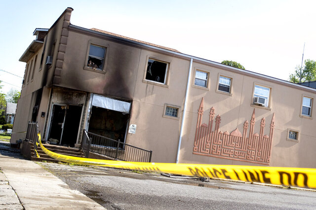 This Friday, April 24, 2020 photo shows damage to the Islamic Center of Cape Girardeau, Mo. after a fire.   The FBI is offering a $5,000 reward for information leading to the arrest of anyone connected to a fire that badly damaged the center in southeast Missouri.  Fire broke out early Friday at the Islamic Center of Cape Girardeau. About 12 to 15 people were evacuated and escaped injury.  (Jacob Wiegand/The Southeast Missourian via AP)