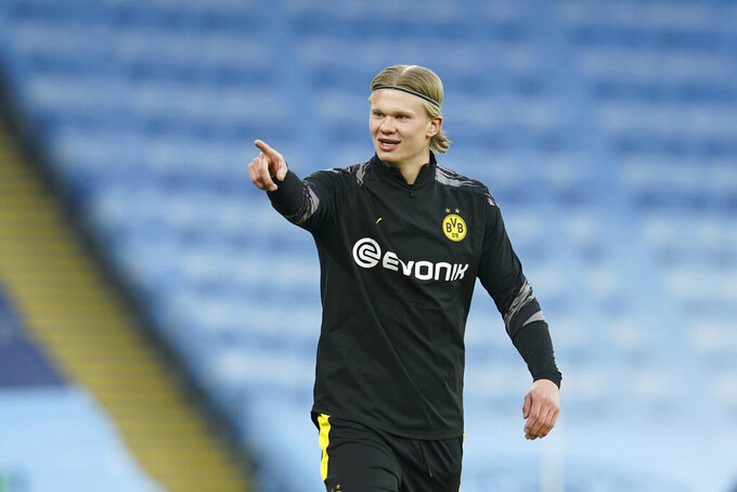 Dortmund's Erling Braut Haaland warms up before the Champions League, first leg, quarterfinal soccer match between Manchester City and Borussia Dortmund at the Etihad stadium in Manchester, Tuesday, April 6, 2021. (AP Photo/Dave Thompson)