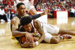 Iowa State guard Prentiss Nixon fights for a loose ball with Baylor forward Tristan Clark, left, during the first half of an NCAA college basketball game Wednesday, Jan. 29, 2020, in Ames, Iowa. (AP Photo/Charlie Neibergall)