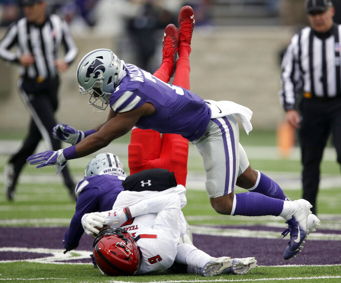 Kansas State defensive back Eli Walker (7) knocks down Texas Tech wide receiver T.J. Vasher (9) during the first half of an NCAA college football game in Manhattan, Kan., Saturday, Nov. 17, 2018. (AP Photo/Orlin Wagner)