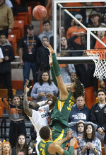 Baylor forward Freddie Gillespie (33) blocks a shot by Oklahoma State guard Isaac Likekele (13) during the second half of an NCAA college basketball game in Stillwater, Okla., Saturday, Jan. 18, 2020. Baylor defeated Oklahoma State 75-68. (AP Photo/Brody Schmidt)