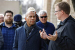 Democratic presidential candidate former Massachusetts Gov. Deval Patrick, center, listens to State Sen. Rob Hogg, right, during a walking tour, Monday, Nov. 18, 2019, in Cedar Rapids, Iowa. (AP Photo/Charlie Neibergall)
