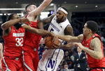 Northwestern center Dererk Pardon (5) vies for a rebound against Ohio State guard Keyshawn Woods, forward Kyle Young, second from left, and guard Duane Washington Jr., during the second half of an NCAA college basketball game Wednesday, March 6, 2019, in Evanston, Ill. (AP Photo/Nam Y. Huh)