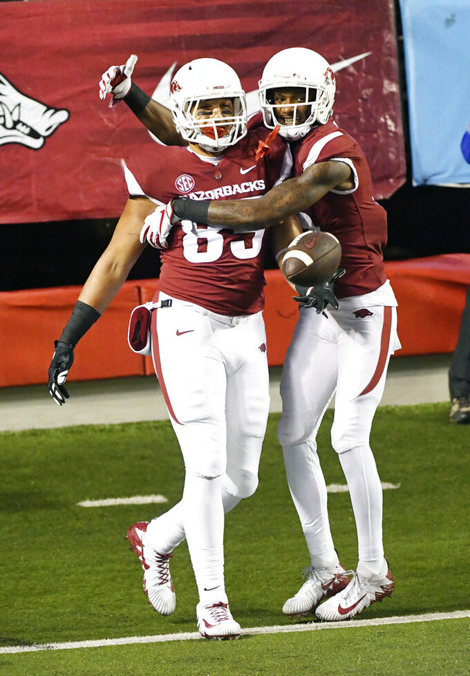 Arkansas tight end Cheyenne O'Grady, left, celebrates with teammate Jordan Jones after a touchdown catch against Mississippi in the first half of an NCAA college football game Saturday, Oct. 13, 2018, in Little Rock, Ark. (AP Photo/Michael Woods)