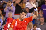 Canada's Milos Raonic waves to the crowd as he walks off the court after withdrawing from his match against countryman Felix Auger-Aliassime during the Rogers Cup men's tennis tournament Wednesday, Aug. 7, 2019, in Montreal. (Paul Chiasson/The Canadian Press via AP)