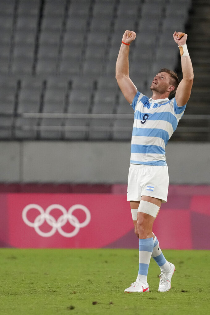Argentina's Matias Osadczuk celebrates after Argentina defeated South Africa in their men's rugby sevens quarterfinal match at the 2020 Summer Olympics, Tuesday, July 27, 2021 in Tokyo, Japan. (AP Photo/Shuji Kajiyama)