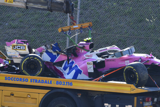 The car of Racing Point driver Lance Stroll of Canada is carried away after the crash during Formula One Grand Prix of Tuscany, at the Mugello circuit in Scarperia, Italy, Sunday, Sept. 13, 2020. (Claudio Giovannini, Pool via AP)