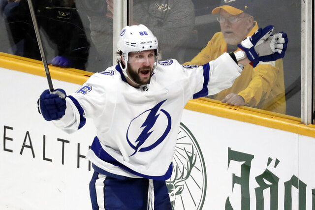 Tampa Bay Lightning right wing Nikita Kucherov, of Russia, celebrates after scoring the winning goal during overtime in an NHL hockey game against the Nashville Predators Tuesday, Dec. 3, 2019, in Nashville, Tenn. The Lightning won 3-2. (AP Photo/Mark Humphrey)