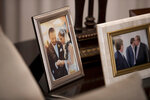 A wedding photo of presidential frontrunner Nayib Bukele, of the Grand National Alliance for Unity or GANA, and is wife Gabriela, is displayed on an accent table in Bukele's home in San Salvador, El Salvador, Tuesday, Jan. 29, 2019. Salvadorans go to the polls to elect a new president on Sunday. (AP Photo/Moises Castillo)