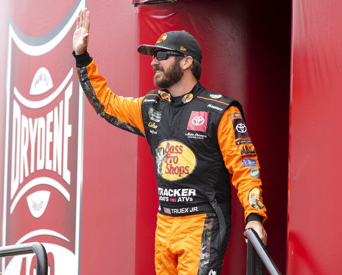 Martin Truex Jr. No. (19) walks on to the stage during driver introductions at the Drydene 400 - Monster Energy NASCAR Cup Series playoff auto race, Sunday, Oct. 6, 2019, at Dover International Speedway in Dover, Del. (AP Photo/Jason Minto)arc