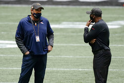 Denver Broncos head coach Vic Fangio, left and Atlanta Falcons head coach Raheem Morris speaks before the first half of an NFL football game, Sunday, Nov. 8, 2020, in Atlanta. (AP Photo/Brynn Anderson)