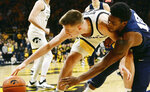 Iowa's Joe Wieskamp, left, and Penn State's Izaiah Brockington struggle for a loose ball during the first half of an NCAA college basketball game, Saturday, Feb. 29, 2020, in Iowa City, Iowa. (AP Photo/Cliff Jette)