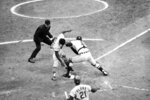 """FILE - Lou Brock of the St. Louis Cardinals is tagged out at home plate by Detroit Tigers catcher Bill Freehan in the fifth inning of World Series Game 5 at Tiger stadium in Detroit, in this Monday, Oct. 7, 1968, file photo. Watching is umpire Doug Harvey who made the call. Freehan, an 11-time All-Star catcher with the Detroit Tigers and key player on the 1968 World Series championship team, has died at age 79. """"It's with a heavy heart that all of us with the Detroit Tigers extend our condolences to the friends and family of Bill Freehan,"""" the team said Thursday, Aug. 19, 2021. (AP Photo/File)"""