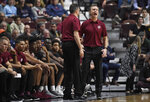 Massachusetts head coach Matt McCall, right, reacts and is held back by assistant coach Tony Bergeron after his bench is called for a technical foul during the second half of an NCAA college basketball game against Virginia, Saturday, Nov. 23, 2019, in Uncasville, Conn. (AP Photo/Jessica Hill)