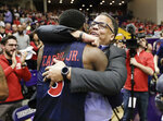 Liberty head coach Ritchie McKay hugs guard Lovell Cabbil Jr. (3) after Liberty beat Lipscomb in the Atlantic Sun NCAA college basketball tournament championship game Sunday, March 10, 2019, in Nashville, Tenn. Liberty won 74-68. (AP Photo/Mark Humphrey)