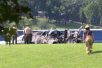 The burned remains of a plane that was carrying NASCAR television analyst and former driver Dale Earnhardt Jr. lies near a runway Thursday, Aug. 15, 2019, in Elizabethton, Tenn. Officials said the Cessna Citation rolled off the end of a runway and caught fire after landing at Elizabethton Municipal Airport. Earnhardt's sister, Kelley Earnhardt Miller, tweeted that