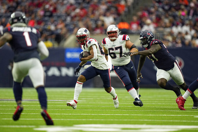 New England Patriots wide receiver Kendrick Bourne (84) catches a pass for a gain as Houston Texans linebacker Kamu Grugier-Hill (51) defends during the first half of an NFL football game Sunday, Oct. 10, 2021, in Houston. (AP Photo/Eric Christian Smith)