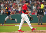 Cleveland Indians starting pitcher Eli Morgan, foreground, waits for Milwaukee Brewers' Luis Urias to run the bases after Urias hit a two-run home run in the fourth inning of a baseball game, Friday, Sept. 10, 2021, in Cleveland. (AP Photo/Tony Dejak)
