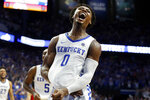 Kentucky's Ashton Hagans celebrates after an overtime win against Louisville in a NCAA college basketball game in Lexington, Ky., Saturday, Dec. 28, 2019. (AP Photo/James Crisp)