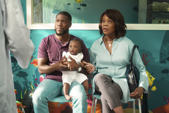 """This image released by Netflix shows Kevin Hart, left, and Alfre Woodard in a scene from """"Fatherhood."""" (Philippe Bosse/Netflix via AP)"""