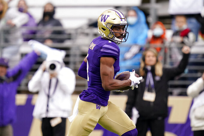 Washington's Terrell Bynum races to a touchdown on a pass reception against Arkansas State in the second half of an NCAA college football game, Saturday, Sept. 18, 2021, in Seattle. (AP Photo/Elaine Thompson)