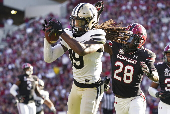 Vanderbilt wide receiver Chris Pierce Jr. (19) catches a pass against South Carolina defensive back Darius Rush (28) during the first half of an NCAA college football game Saturday, Oct. 16, 2021, in Columbia, S.C. (AP Photo/Sean Rayford)