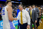 Kentucky's Reid Travis (22) shakes hands with Wofford head coach Mike Young after a second-round game in the NCAA men's college basketball tournament in Jacksonville, Fla. Saturday, March 23, 2019. (AP Photo/Stephen B. Morton)