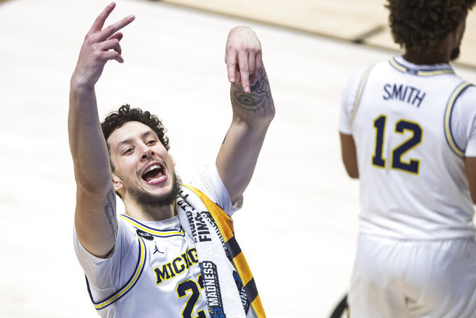 Michigan's Brandon Johns Jr. celebrates as he exits the court following Michigan's win over Texas Southern in a first-round game in the NCAA men's college basketball tournament, Saturday, March 20, 2021, at Mackey Arena in West Lafayette, Ind.  (AP Photo/Robert Franklin)